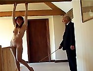 Beautiful girl stripped naked and brutally caned - hot welted and bruised ass