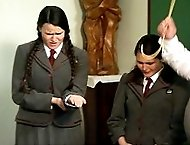 Two chubby school girls in uniform receive painful caning across their palms - hot streaming tears