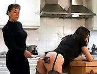 Two cuties with stunning bottoms bend over the kitchen table and spread their cheeks in pain