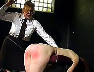 Young naked cutie bent over the bench for a searing spanking and caning on her upturned cheeks