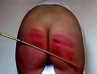 Searing caning on her gorgeous big ass - white panties - red stripes - purple bruises
