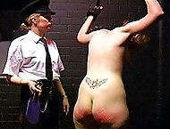Naked blonde shackled and severely strapped on her luscious big bare ass - burning red bottocks