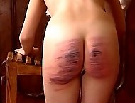 Helpless girl get her bottom caned beyond all recognition